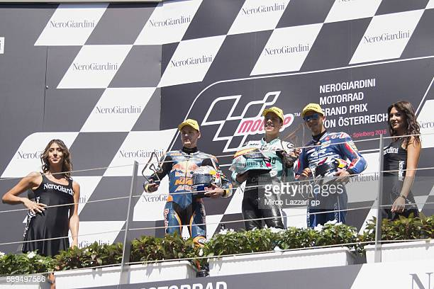 Brad Binder of South Africa and Red Bull KTM Ajo Joan Mir of Spain and Leopard Racing and Enea Bastianini of Italy and Gresini Racing Moto3 celebrate...