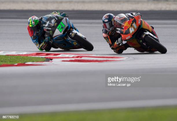Brad Binder of South Africa and Red Bull KTM Ajo leads Franco Morbidelli of Italy and EG 00 Marc VDS during the Moto2 race during the MotoGP Of...