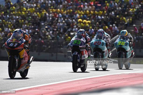 Brad Binder of South Africa and Red Bull KTM Ajo leads the field during the Moto3 race during the MotoGp of Austria Race at Red Bull Ring on August...