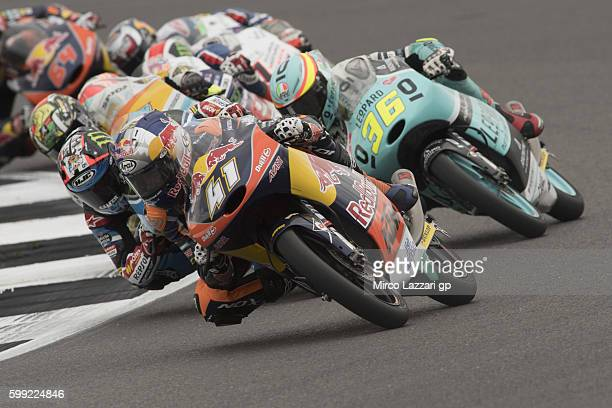Brad Binder of South Africa and Red Bull KTM Ajo leads the field during the Moto3 race during the MotoGp Of Great Britain Race at Silverstone Circuit...
