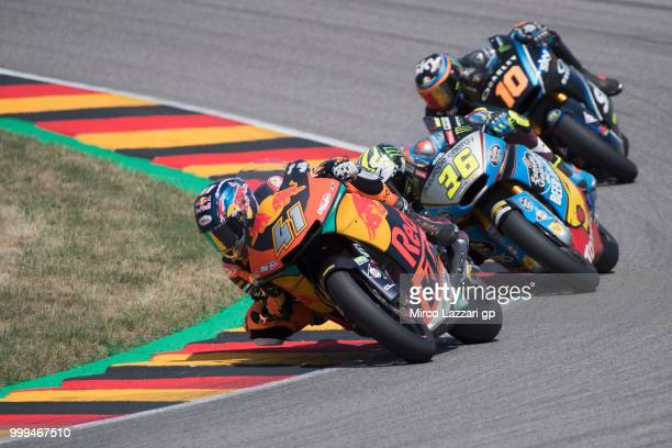 Brad Binder of South Africa and Red Bull KTM Ajo leads the field during the Moto2 race during the MotoGp of Germany Race at Sachsenring Circuit on...