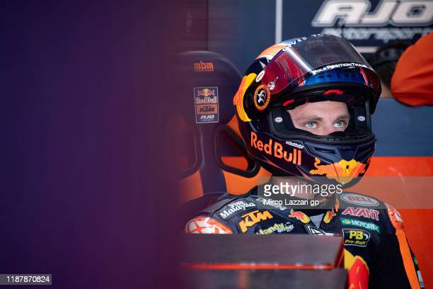 Brad Binder of South Africa and Red Bull KTM Ajo looks on in box during the MotoGP Of Valencia - Free Practice at Ricardo Tormo Circuit on November...