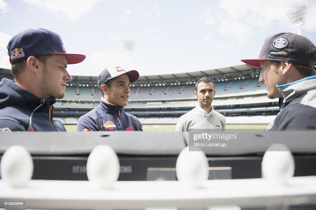 Brad Binder of South Africa and Red Bull KTM Ajo, Marc Marquez of Spain and Repsol Honda Team and Jack Miller of Australia and Marc VDS Racing Team speak during the pre-event in Melbourne Cricket Ground during the MotoGP of Australia - Pre-Event Activities on October 19, 2016 in Melbourne, Australia.