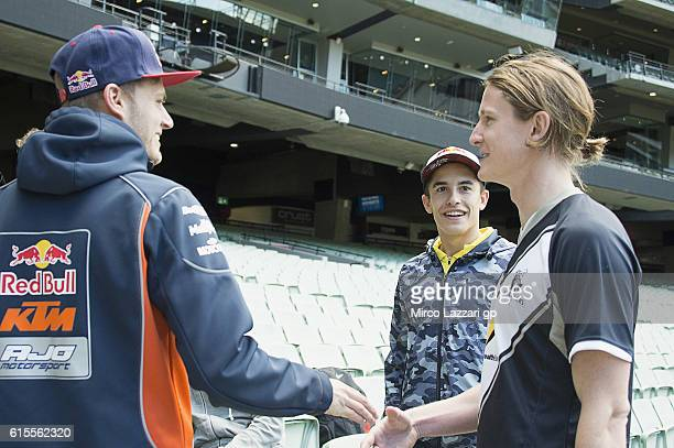 Brad Binder of South Africa and Red Bull KTM Ajo Marc Marquez of Spain and Repsol Honda Team and Guy Walker of Australia speak during the preevent in...