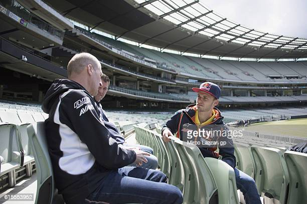 Brad Binder of South Africa and Red Bull KTM Ajo speaks with Aki Ajo of Finland during the preevent in Melbourne Cricket Ground during the MotoGP of...