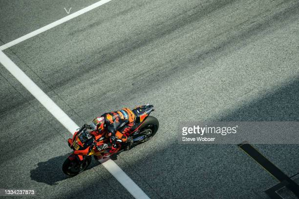 Brad Binder of South Africa and Red Bull KTM Factory Racing crosses the line on the main straight during the warmup of MotoGP Bitci Motorrad Grand...
