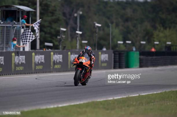 Brad Binder of South Africa and Red Bull KTM Factory Racing cuts the finish lane and celebrates the victory at the end of the MotoGP race during the...