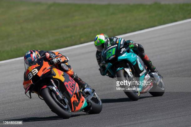 Brad Binder of South Africa and Red Bull KTM Factory Racing leads Franco Morbidelli of Italy and Petronas Yamaha SRT during the MotoGP race during...