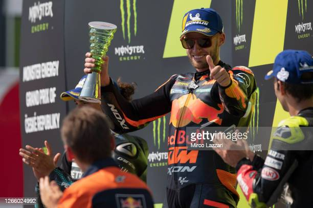 Brad Binder of South Africa and Red Bull KTM Factory Racing celebrates the victory on the podium at the end of the MotoGP race during the MotoGP Of...
