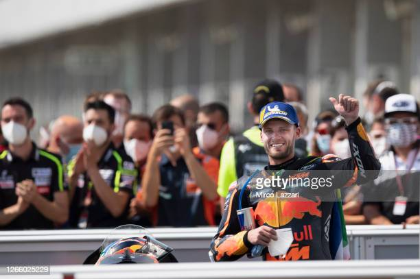 Brad Binder of South Africa and Red Bull KTM Factory Racing celebrates the victory under the podium at the end of the MotoGP race during the MotoGP...