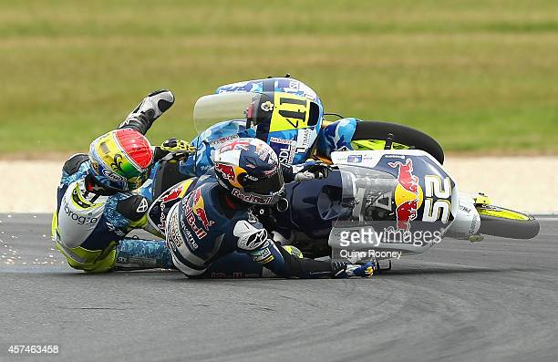 Brad Binder of South Africa and the Ambrogio Racing Mahindra and Danny Kent of Great Britain and the Red Bull Husqvarna AJO Husqvarna crash during...