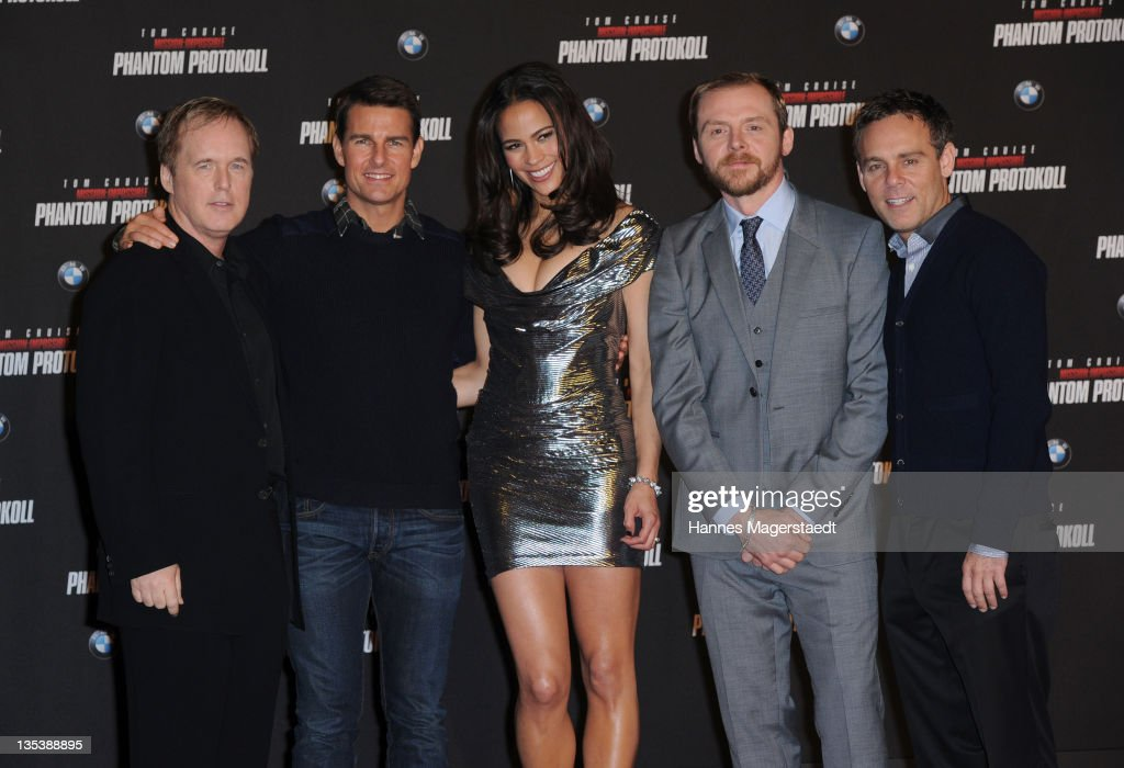 Brad Bird, actors Tom Cruise, Paula Patton, Simon Pegg and procucer Bryan Burk attend the 'Mission: Impossible - Ghost Protocol' Premiere at the BMW Welt on December 9, 2011 in Munich, Germany.