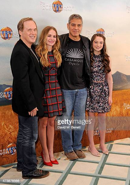 Brad Bird Britt Robertson George Clooney and Raffey Cassidy pose at a photocall for 'Tomorrowland' at Claridge's Hotel on May 18 2015 in London...
