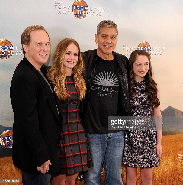 Brad Bird Britt Robertson George Clooney and Raffey Cassidy pose at a photocall for Tomorrowland at Claridge's Hotel on May 18 2015 in London England
