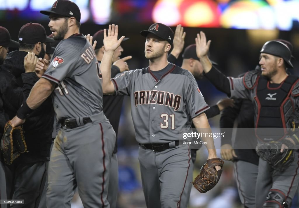 Brad Boxberger #31 of the Arizona Diamondbacks is congratulated on his 8-7 save over the Los Angeles Dodgers at Dodger Stadium on April 13, 2018 in Los Angeles, California.