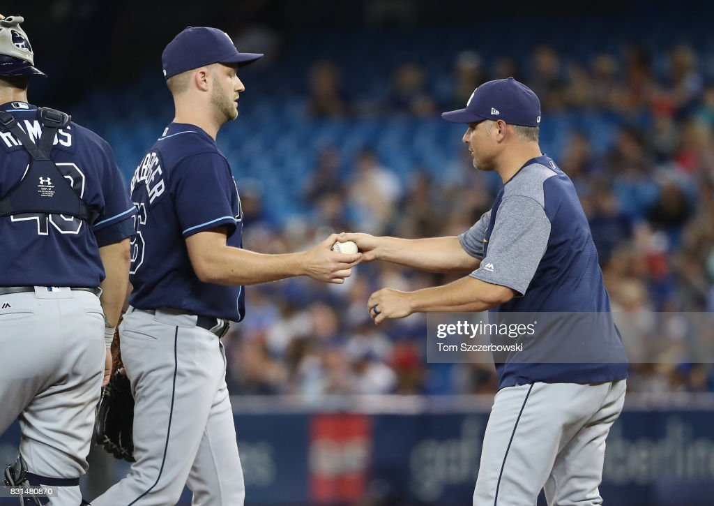Brad Boxberger #26 of the Tampa Bay Rays exits the game as he is relieved by manager Kevin Cash #16 in the first inning during MLB game action against the Toronto Blue Jays at Rogers Centre on August 14, 2017 in Toronto, Canada.
