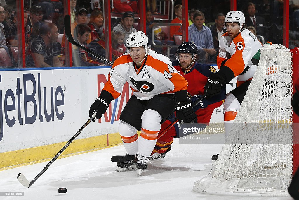 Brad Boyes #24 of the Florida Panthers pursues Kimmo Timonen #44 of the Philadelphia Flyers as he circles the net with the puck at the BB&T Center on April 8, 2014 in Sunrise, Florida.