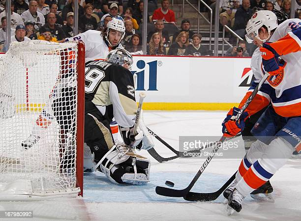Brad Boyes of the New York Islanders shoots and scores against Marc-Andre Fleury of the Pittsburgh Penguins in Game Two of the Eastern Conference...