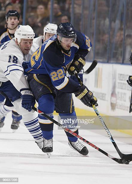 Brad Boyes of the St Louis Blues battles for the puck with Wayne Primeau of the Toronto Maple Leafs on February 12 2010 at Scottrade Center in St...