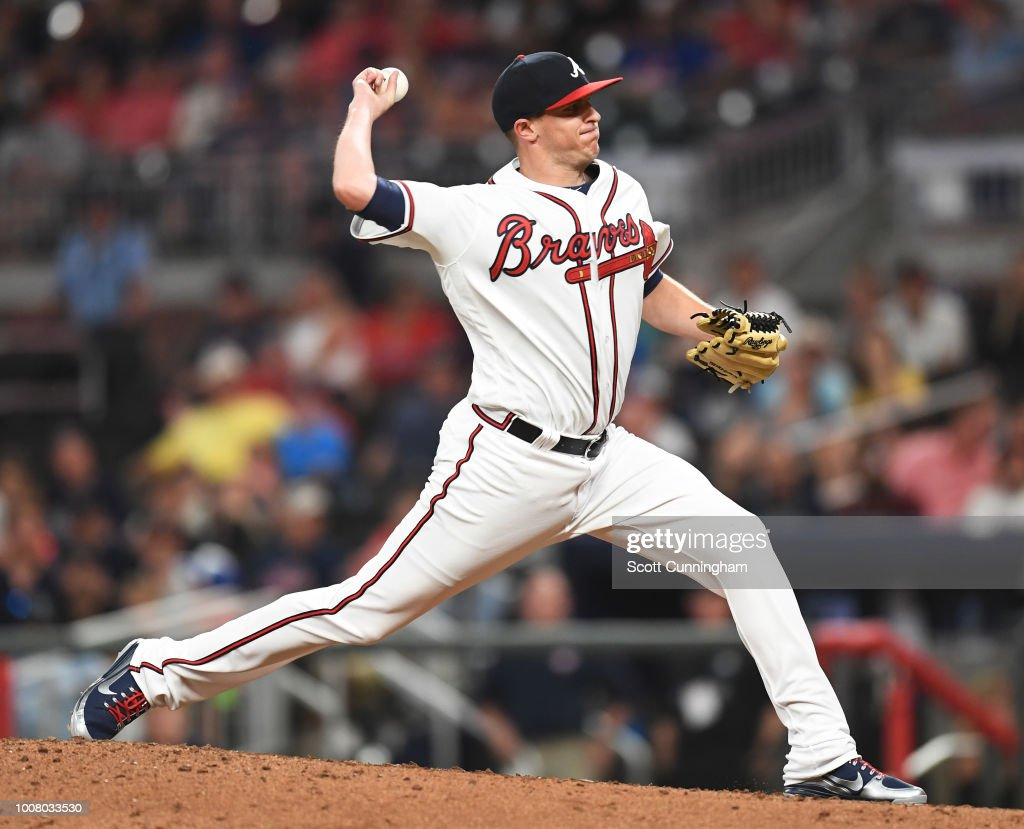 Brad Brach #46 of the Atlanta Braves throws in eighth inning pitch against the Miami Marlins at SunTrust Park on July 30, 2018 in Atlanta, Georgia.