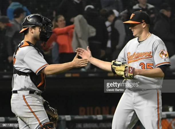 Brad Brach of the Baltimore Orioles and Andrew Susac celebrate their win against the Chicago White Sox on May 21 2018 at Guaranteed Rate Field in...