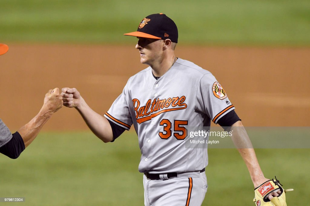 Brad Brach #35 of the Baltimore Orioles celebrates a win after a baseball game against the Washington Nationals at Nationals Park on June 20, 2018 in Washington, DC.