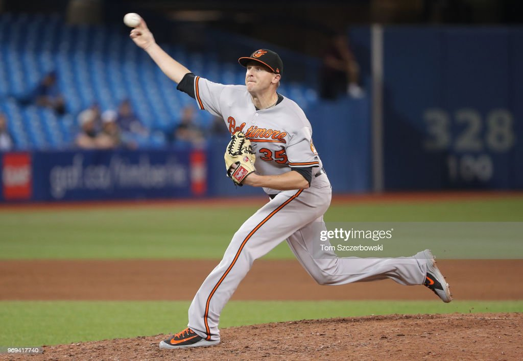 Brad Brach #35 of the Baltimore Orioles delivers a pitch in the ninth inning during MLB game action against the Toronto Blue Jays at Rogers Centre on June 7, 2018 in Toronto, Canada.