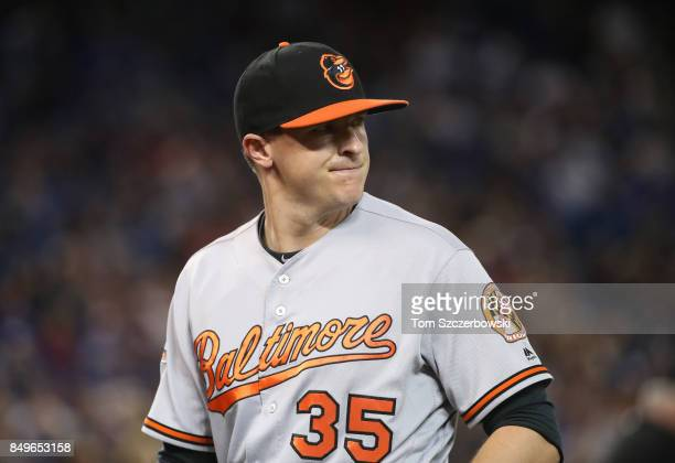 Brad Brach of the Baltimore Orioles exits the game as he is relieved in the eighth inning during MLB game action against the Toronto Blue Jays at...