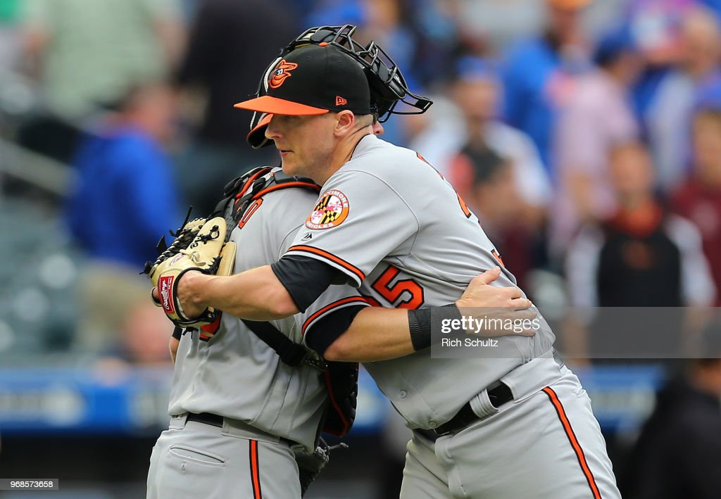 Brad Brach #35 of the Baltimore Orioles is hugged by catcher Chance Sisco #15 after defeating the New York Mets 1-0 at Citi Field on June 6, 2018 in the Flushing neighborhood of the Queens borough of New York City.