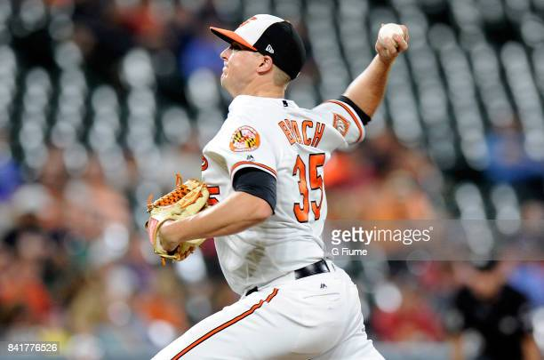 Brad Brach of the Baltimore Orioles pitches against the Oakland Athletics at Oriole Park at Camden Yards on August 21 2017 in Baltimore Maryland