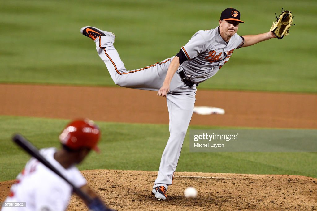 Brad Brach #35 of the Baltimore Orioles pitches in ninth inning during a baseball game against the Washington Nationals at Nationals Park on June 20, 2018 in Washington, DC.