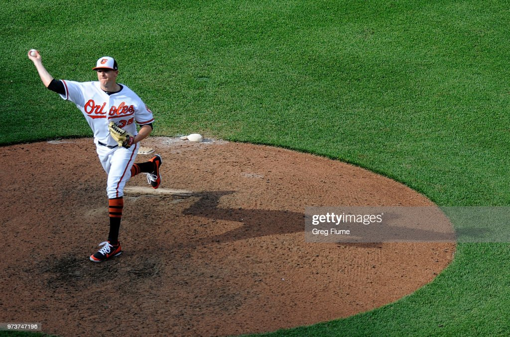 Brad Brach #35 of the Baltimore Orioles pitches in the eighth inning against the Boston Red Sox at Oriole Park at Camden Yards on June 13, 2018 in Baltimore, Maryland.