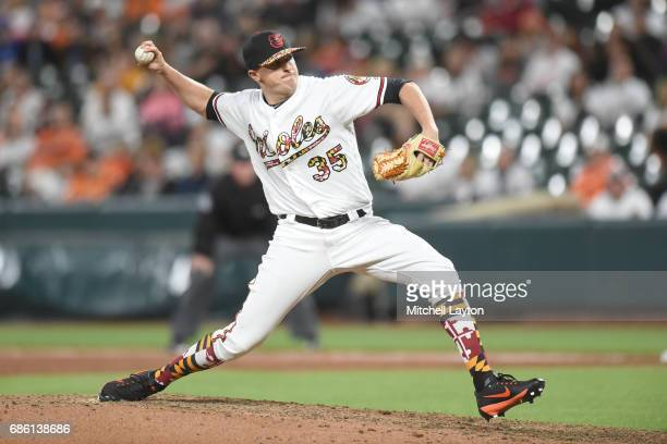 Brad Brach of the Baltimore Orioles pitches in the ninth inn for his ninth save during a baseball game against the Toronto Blue Jays at Oriole Park...