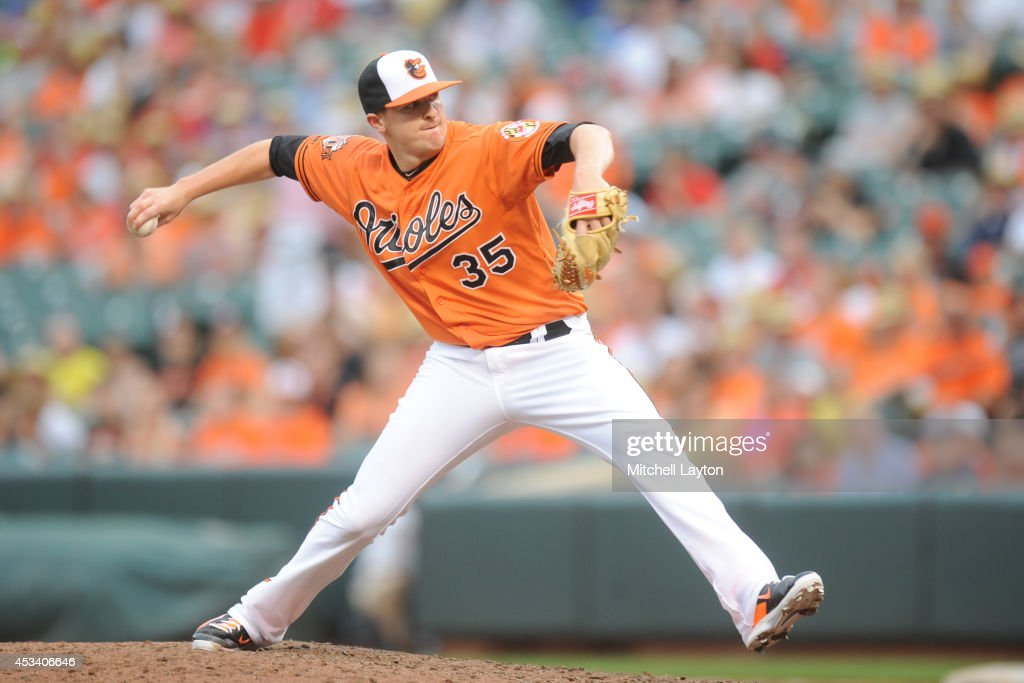 Brad Brach #35 of the Baltimore Orioles pitches in the ninth inning during a baseball game against the St. Louis Cardinals on August 9, 2014 at Oriole Park at Camden Yards in Baltimore, Maryland. The Orioles won 10-3.