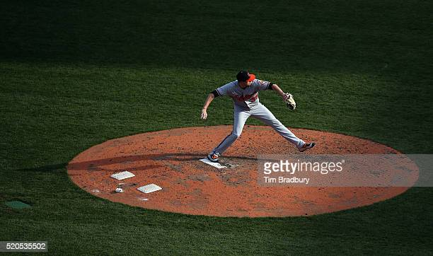 Brad Brach of the Baltimore Orioles throws a pitch in the eighth inning against the Boston Red Sox during the home opener at Fenway Park on April 11...