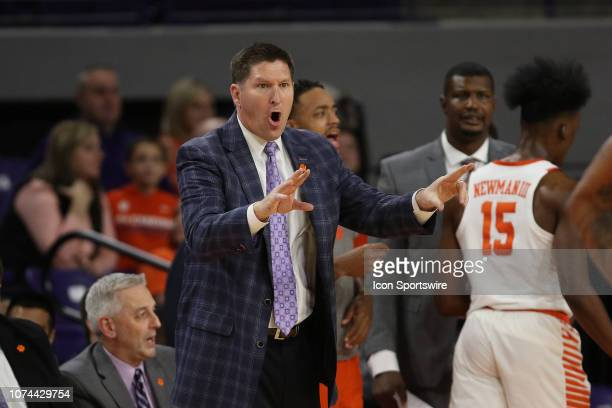 Brad Brownell head coach of Clemson directs his team from the side lines during a college basketball game between the Charleston Southern Buccaneers...