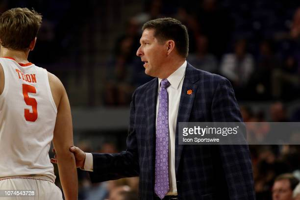 Brad Brownell head coach of Clemson talks with Hunter Tyson forward of Clemson during a college basketball game between the Charleston Southern...