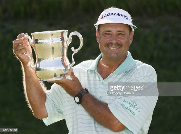 Brad Bryant holds up his trophy after winning the United States Senior Open at Whistling Straits July 8 2007 in Kohler Wisconsin Bryant finshed at 6...
