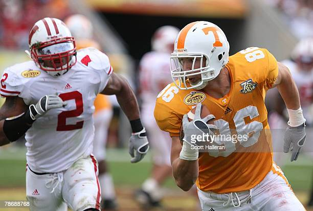 Brad Cottam of the Tennessee Volunteers runs for a first half touchdown past Jonathan Cassilas of the Wisconsin Badgers during the Outback Bowl at...