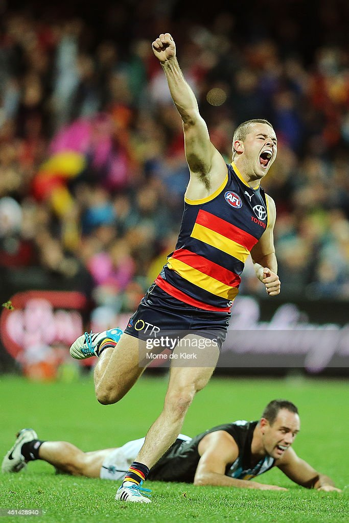 Brad Crouch of the Crows celebrates after kicking a goal during the round 15 AFL match between the Adelaide Crows and the Port Adelaide Power at Adelaide Oval on June 29, 2014 in Adelaide, Australia.