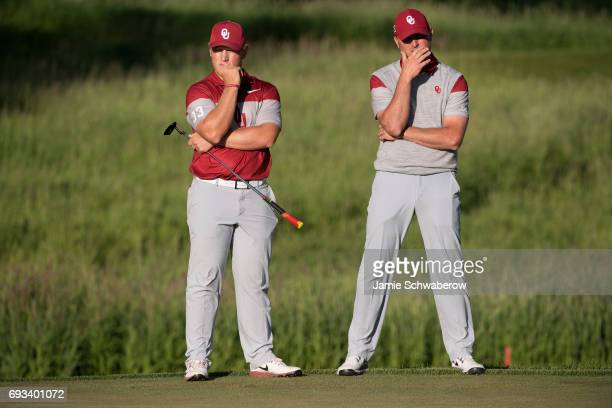 Brad Dalke and Head Coach Ryan Hybl of the University of Oklahoma line up a putt during the Division I Men's Golf Team Championship held at Rich...
