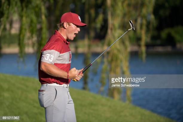 Brad Dalke of the University of Oklahoma celebrates after sinking the winning putt during the Division I Men's Golf Team Championship held at Rich...