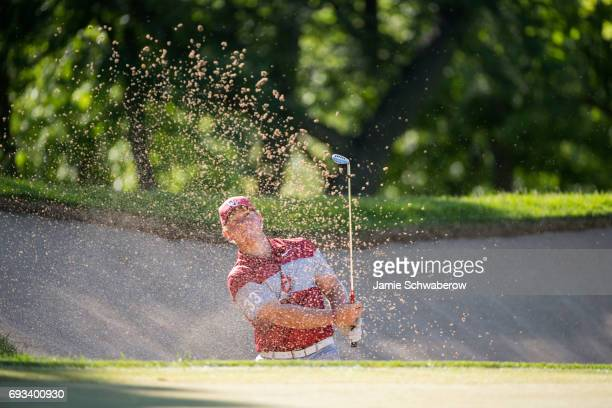 Brad Dalke of the University of Oklahoma chips out of the sand during the Division I Men's Golf Team Championship held at Rich Harvest Farms on May...