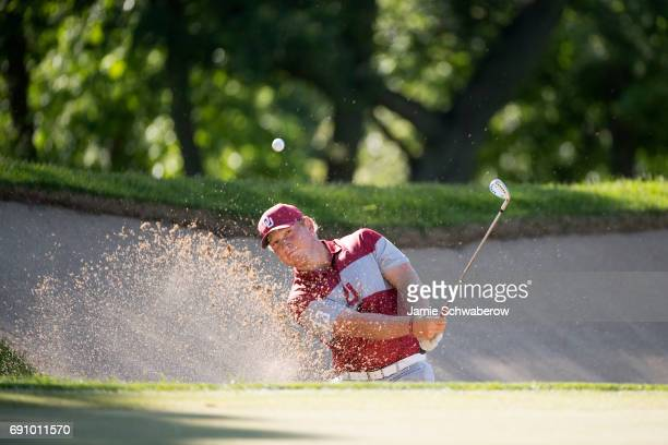 Brad Dalke of the University of Oklahoma hits out of the sand trap during the Division I Men's Golf Team Championship held at Rich Harvest Farms on...