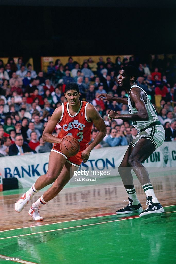 Brad Daugherty #43 of the Cleveland Cavaliers drives to the basket against Robert Parish #00 of the Boston Celtics during a game played in 1987 at the Boston Garden in Boston, Massachusetts.