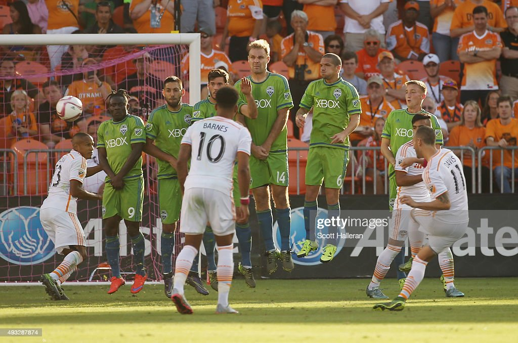 Brad Davis #11 of Houston Dynamo takes a penalty shot over a wall of Seattle Sounders FC defenders in the second half of their game at BBVA Compass Stadium on October 18, 2015 in Houston, Texas.