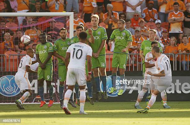 Brad Davis of Houston Dynamo takes a penalty shot over a wall of Seattle Sounders FC defenders in the second half of their game at BBVA Compass...