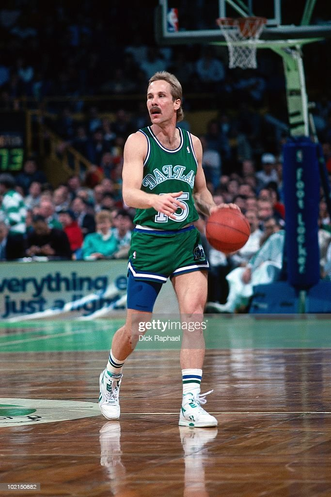 Brad Davis #15 of the Dallas Mavericks moves the ball up court against the Boston Celtics during a game played in 1990 at the Boston Garden in Boston, Massachusetts.