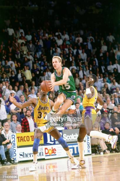 Brad Davis of the Dallas Mavericks shoots a short jump shot against Magic Johnson of the Los Angeles Lakers during a game played in 1988 at the Great...