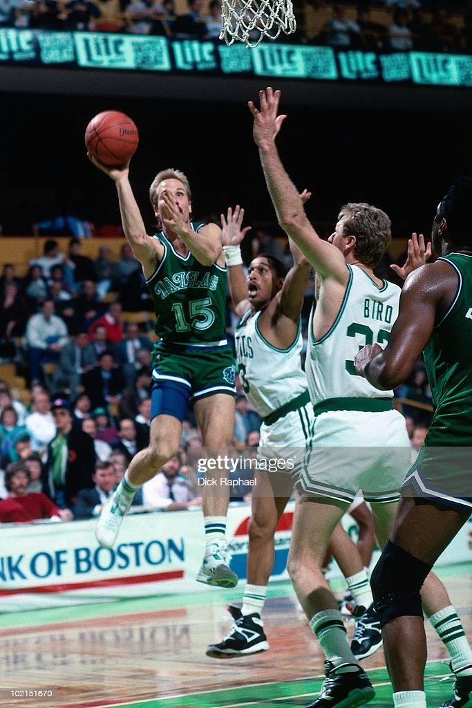 Brad Davis #15 of the Dallas Mavericks shoots against the Boston Celtics during a game played in 1990 at the Boston Garden in Boston, Massachusetts.